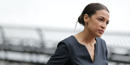 Alexandria Ocasio-Cortez talks to a reporter in New York, Wednesday, June 27, 2018. The 28-year-old political newcomer who upset U.S. Rep. Joe Crowley in New York's Democrat primary says she brings an