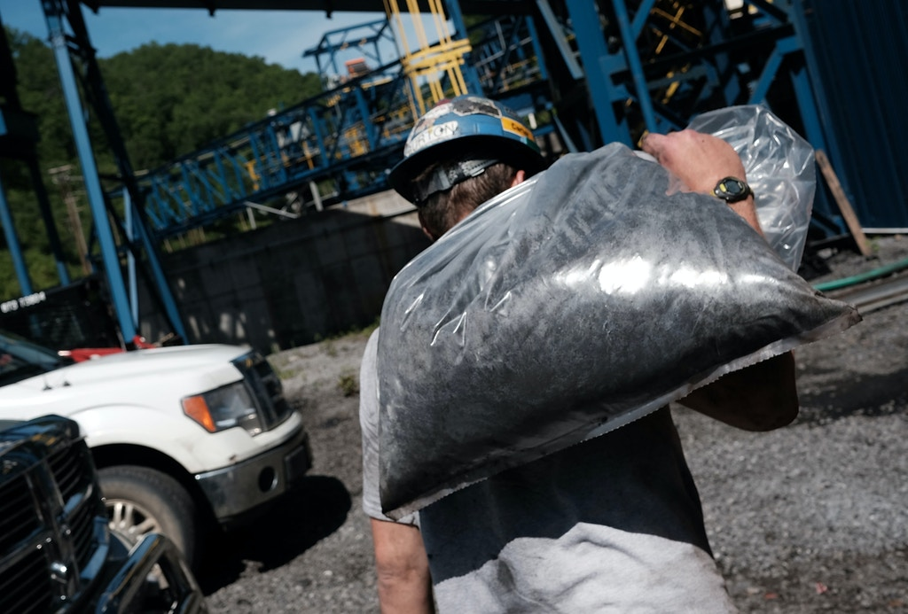 WELCH, WV - MAY 19: A man takes coal samples at a coal prep plant on May 19, 2017 outside the city of Welch, West Virginia. West Virginia, a state where President Donald Trump won in a landslide by defeating Hillary Clinton 67.9 percent to 26.2 percent, is also one of the nations poorest states where nearly one in five West Virginians struggled to afford basic necessities in 2015. The state was historically dependent on coal mining and manufacturing. While mine employment is up slightly since the election, the state has continued to see a surge in male unemployment and an epidemic of opioid use among its population. (Photo by Spencer Platt/Getty Images)
