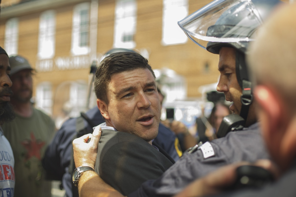 Jason Kessler was forcibly removed by State Police. Jason Kessler, one of the main organizers for the Unite The Right Rally held this weekend in Charlottesville, Attempted to hold a press conference to counter the events of Saturday. The Presser last about 3 minutes before Kessler was chased and beaten. He was evacuated by Virginia State Police. (Photo by Shay Horse/NurPhoto via Getty Images)