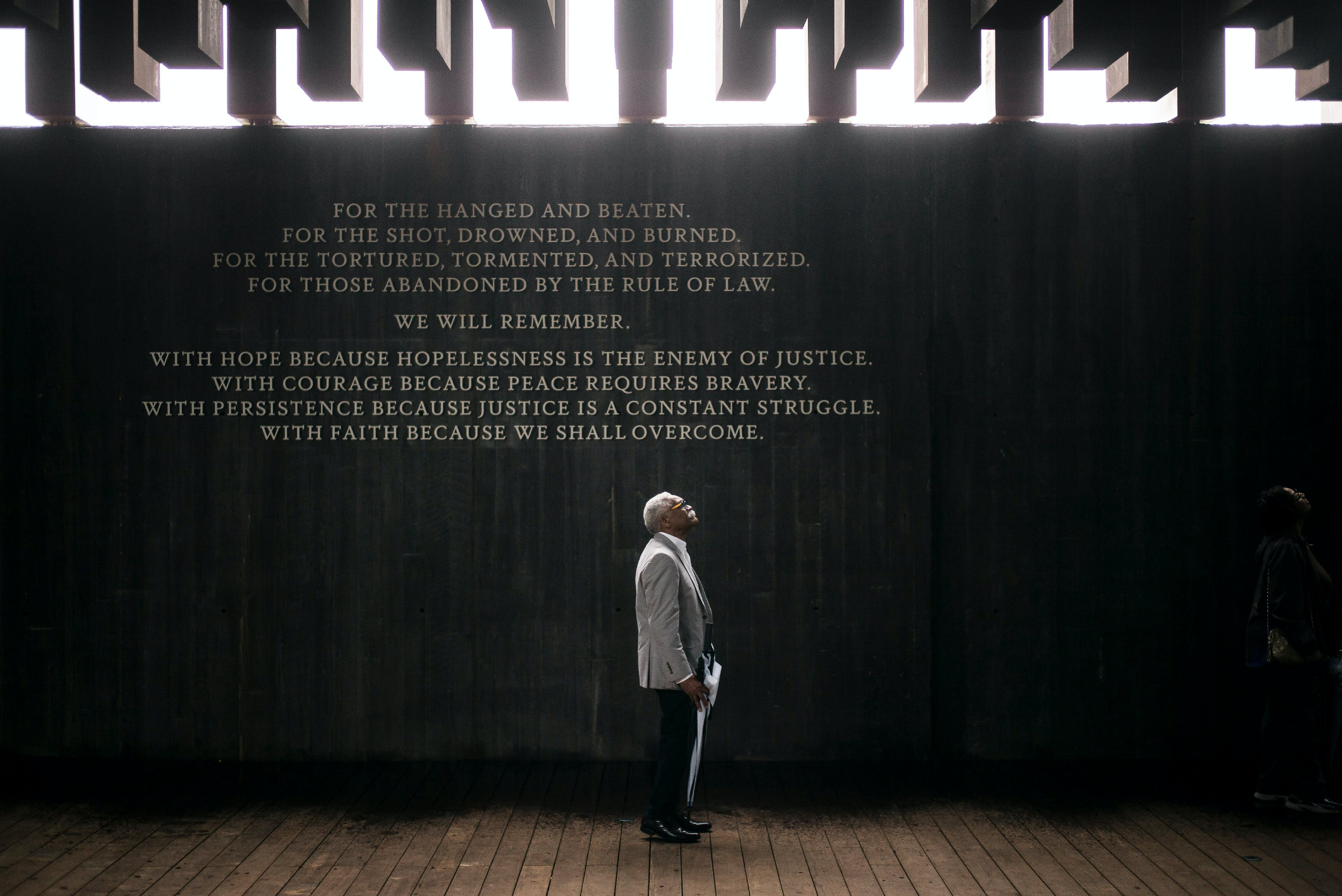 "MONTGOMERY, AL - APRIL 26: Ed Sykes, 77, visits the National Memorial For Peace And Justice on April 26, 2018 in Montgomery, Alabama. Sykes, who has family in Mississippi, was distraught when he discovered his last name in the memorial, three months after finding it on separate memorial in Clay County, Mississippi. ""This is the second time I've seen the name Sykes as a hanging victim. What can I say?"" Sykes, who now lives in San Francisco, plans to investigate the lynching of a possible relative at the Equal Justice Initiative headquarters in Montgomery before returning to California. The memorial is dedicated to the legacy of enslaved black people and those terrorized by lynching and Jim Crow segregation in America. Conceived by the Equal Justice Initiative, the physical environment is intended to foster reflection on America's history of racial inequality. (Photo by Bob Miller/Getty Images)"