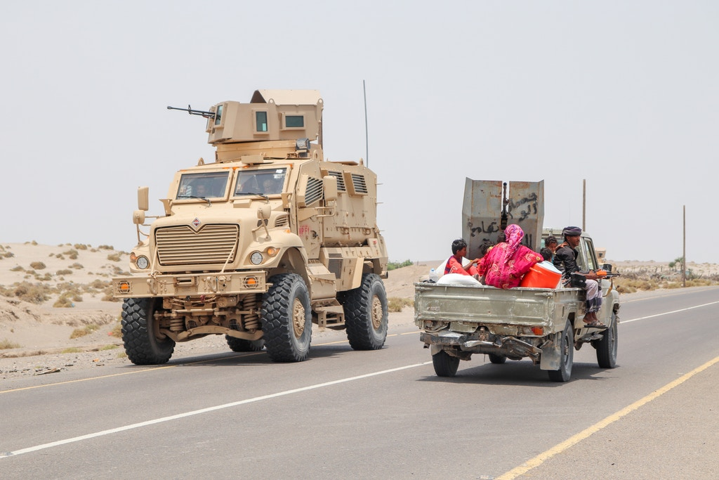Civilians flee fighting as Saudi/UAE coalition supplied armored personnel carriers flank Yemeni Resistance fighters battling for control of the village of Al Buqa, Hodeidah, Yemen 15 May 2018.