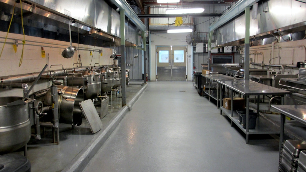 A walkway divides the Seaside galley's halal detainee food prep from the non-halal military personnel food prep, all of which occurs in the same kitchen.