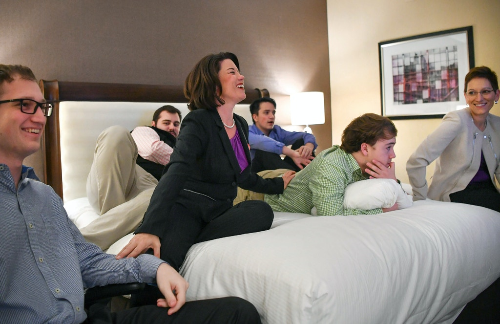 Minnesota Democratic-Farmer-Labor Party 2nd Congressional candidate Angie Craig, center, watches results with her wife, Cheryl Greene, and their four sons, Jonas, Jacob, Josh and Isaac in their hotel room in Minneapolis, Minn., Tuesday, Nov. 8, 2016. (Glen Stubbe/Star Tribune via AP)