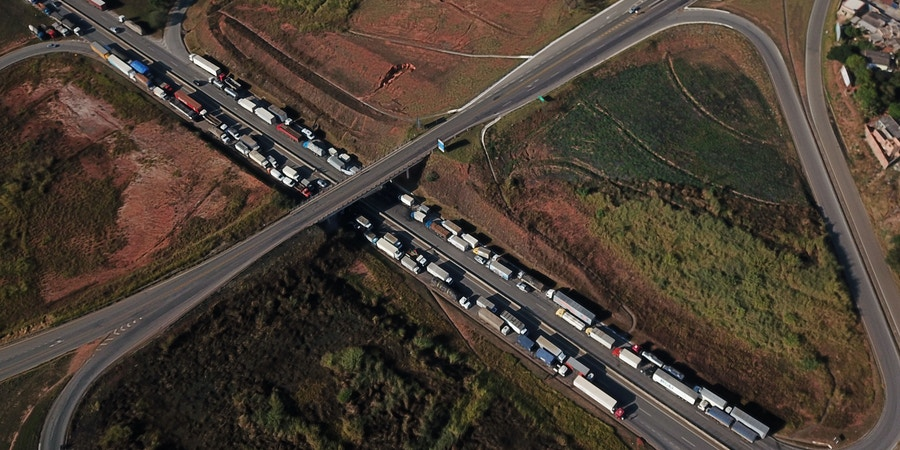 Aerial view of Brazilian truck drivers blocking the BR-262 highway with their trucks, during the fifth day of strike to protest against the diesel fuel price-rise, in Juatuba, Minas Gerais state, Brazil, May 25, 2018. - Brazilian President Michel Temer ordered security forces Friday to clear road blockades set up by truckers who pressed on with a strike that has left the vast country virtually paralyzed. (Photo by DOUGLAS MAGNO / AFP)        (Photo credit should read DOUGLAS MAGNO/AFP/Getty Images)