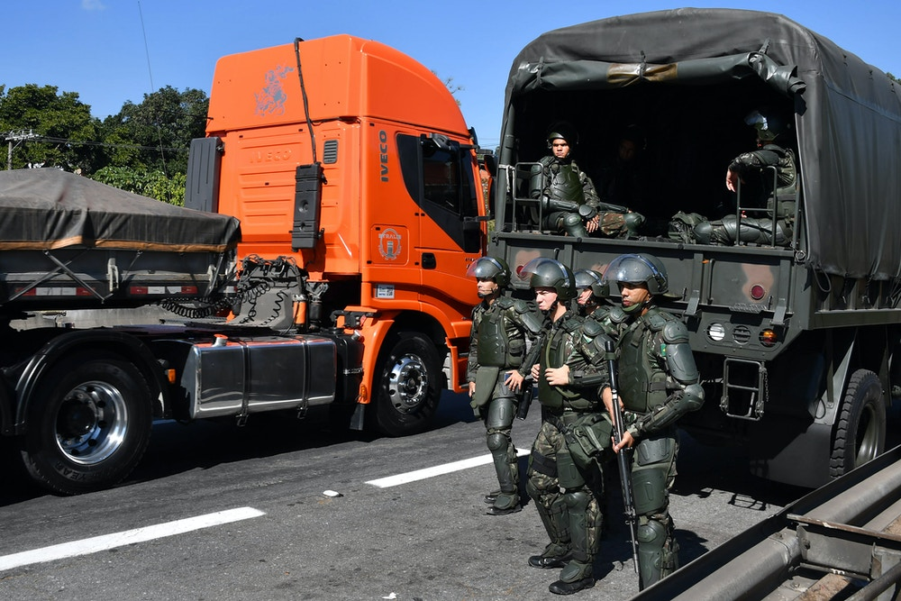 Soldiers take part in an operation to clear highway Regis Bittencourt, 30 km from Sao Paulo, on May 30, 2018 as a truckers' strike against rising fuel costs in Brazil that has left much of the country paralyzed is now over. - Brazilian oil sector workers began a three-day strike Wednesday in at least eight refineries, as the country reeled from the truckers' protest. (Photo by Nelson ALMEIDA / AFP)        (Photo credit should read NELSON ALMEIDA/AFP/Getty Images)