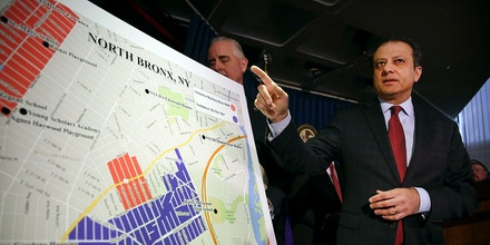 NEW YORK, NY - APRIL 27: Preet Bharara, the United States attorney for the Southern District of New York, gestures at a map showing where 120 people were arrested on gang-related charges on April 27, 2016 in the Bronx borough of New York City. The early morning raid is believed by authorities to be the largest gang takedown in New York City history, affecting members of 2Fly YGz street gang and their rival Big Money Bosses gang. The gangs are accused of being involved in drug and gun sales as well as being responsible for terrorising their respective neighborhoods.  (Photo by Spencer Platt/Getty Images)