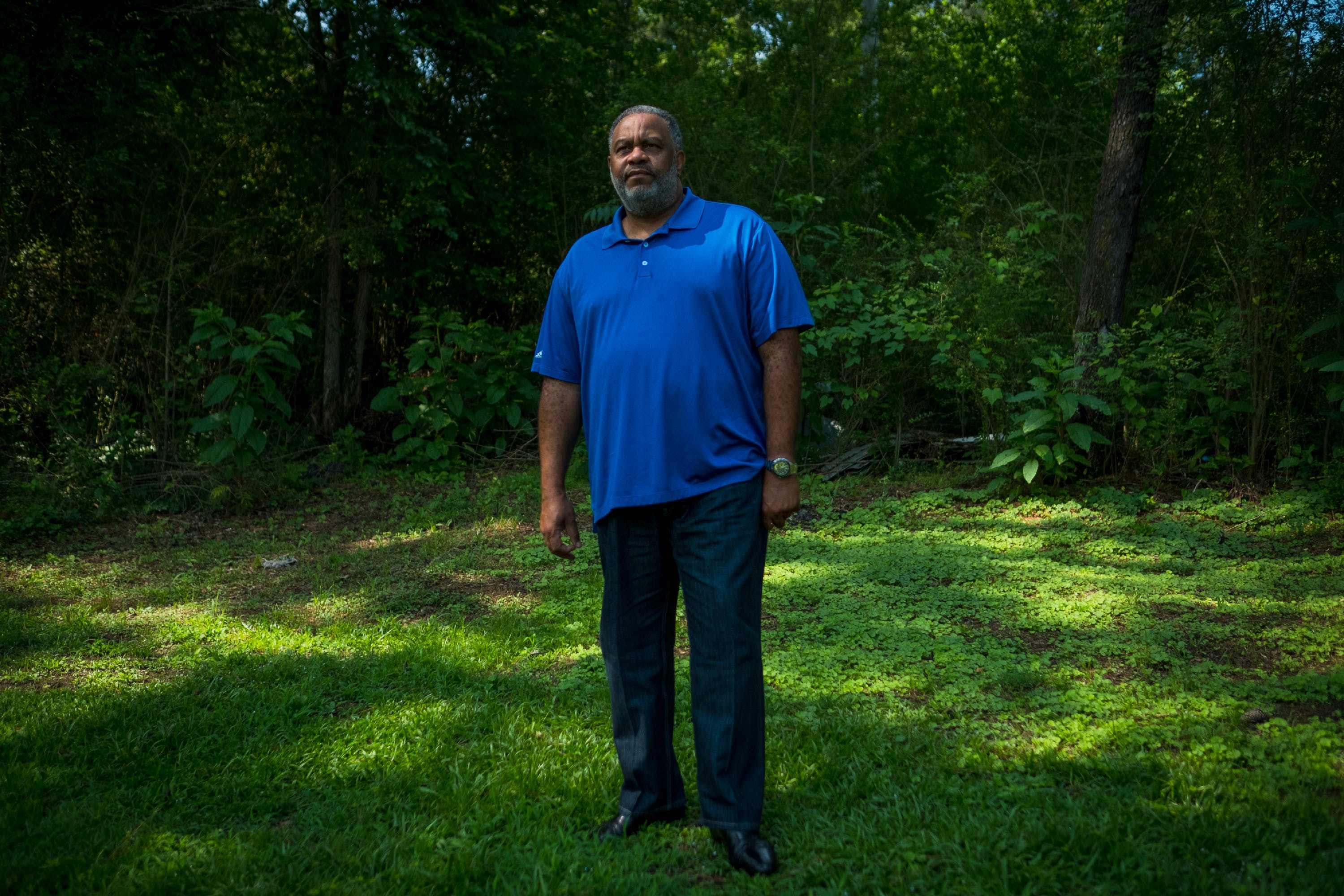 "Anthony Ray Hinton stands near the spot in the yard of his home in Quinton, Alabama, Sunday, June 3, 2018, where Alabama police officers came to arrest him for crimes he didn't commit in 1985. When he is not traveling, Hinton says he spends a lot of time outdoors. ""It just gives me a sense of belonging. When one has been locked up, the last place I want to be is stuck in the house. I love the outdoors."" Hinton spent 30 years on death row after he was wrongfully incarcerated for two murders he did not commit. His recently released his memoir, ""The Sun Does Shine: How I Found Life and Freedom on Death Row.""<br /> (Tamika Moore for The Intercept)"