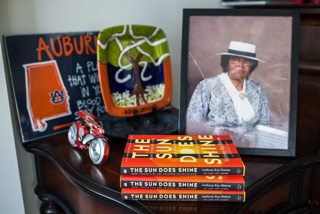 "Anthony Ray Hinton recently released his memoir, ""The Sun Does Shine: How I Found Life and Freedom on Death Row."" A photo of his mother sits next to his books on a side table in his home in Quinton, Alabama, Sunday, June 3, 2018. Hinton spent 30 years on death row after he was wrongfully incarcerated for two murders he did not commit.<br /><br /><br /><br /><br /><br /><br /><br /><br /> (Tamika Moore for The Intercept)"