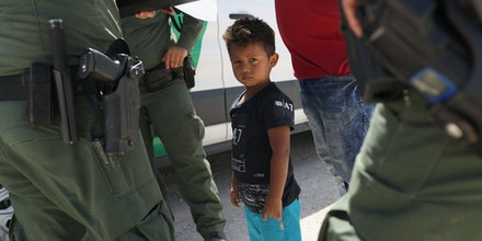 MISSION, TX - JUNE 12:  U.S. Border Patrol agents take into custody a father and son from Honduras near the U.S.-Mexico border on June 12, 2018 near Mission, Texas. The asylum seekers were then sent to a U.S. Customs and Border Protection (CBP) processing center for possible separation. U.S. border authorities are executing the Trump administration's zero tolerance policy towards undocumented immigrants. U.S. Attorney General Jeff Sessions also said that domestic and gang violence in immigrants' country of origin would no longer qualify them for political-asylum status.  (Photo by John Moore/Getty Images)
