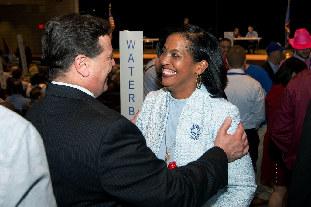 Candidate Jahana Hayes, right, is greeted by Paul Pernerewski, a member of the Waterbury Board of Alderman, during the Democratic convention for the 5th District Monday at Crosby High School in Waterbury, Conn. Hayes is a Democrat seeking the party's endorsement. Democrats were set to pick their nominee to represent the large 5th Congressional District (Jim Shannon/Republican-American via AP)