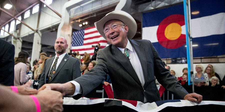 Former Senator and Secretary of the Interior Ken Salazar, D-Colo., greets members of the audience during a rally for Democratic presidential candidate Hillary Clinton at the Colorado State Fairgrounds in Pueblo, Colo., Wednesday, Oct. 12, 2016. (AP Photo/Andrew Harnik)