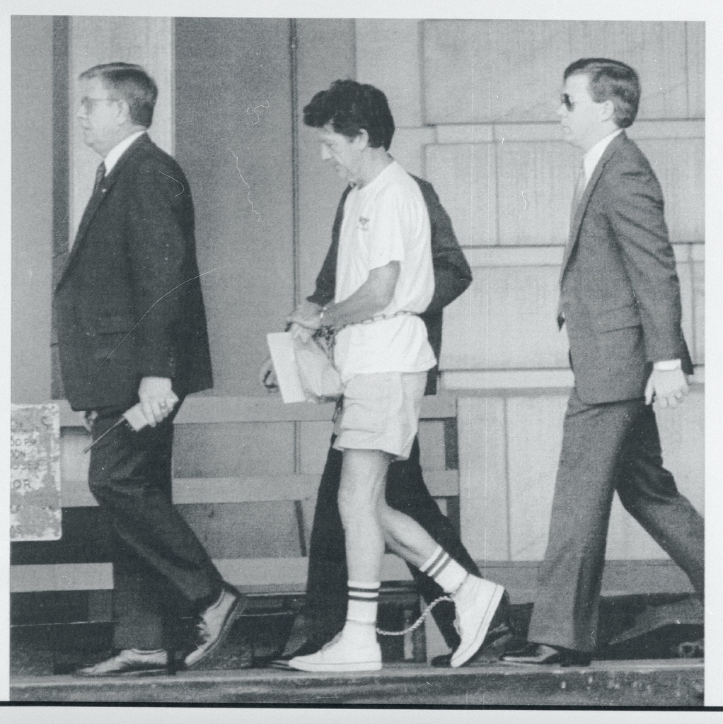 (Original Caption) Bombing suspect Walter Leroy Moody Jr. is shackled and under tight security, as he is led into the Federal Courthouse for the 2nd day in a row, during a bond hearing on charges stemming from a 1972 bombing incident.