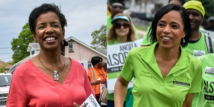 Donna Edwards, left, and Angela Alsobrooks, two of the leading contenders in the Democratic primary race in Prince George county, take part in a local parade in Seat Pleasant, Md., on May 5, 2018.