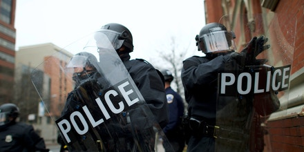 Police officers wearing tactical gear form a barrier with riot shields to prevent the movement of protestors after the inauguration of Donald Trump on Jan. 20, 2017, in Washington D.C.