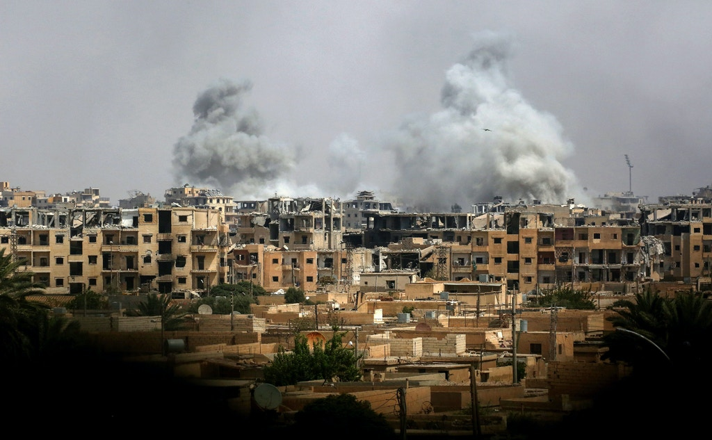 A picture taken on September 5, 2017 shows smoke billowing out following a coalition air strike in the western al-Daraiya neighbourhood of the embattled northern Syrian city of Raqa. / AFP PHOTO / Delil souleiman        (Photo credit should read DELIL SOULEIMAN/AFP/Getty Images)