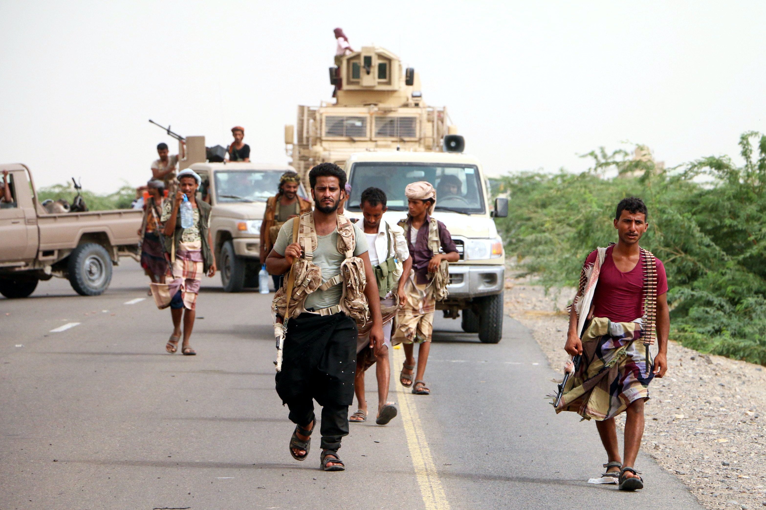 Mandatory Credit: Photo by NAJEEB ALMAHBOOBI/EPA-EFE/REX/Shutterstock (9715391f)<br /><br /><br /><br /><br /><br /><br /><br /> Yemeni forces backed by the Saudi-led coalition take position during an attack on the port city of Hodeidah, on the outskirts of Hodeidah, Yemen, 13 June 2018. According to reports, Yemeni government forces backed by the Saudi-led coalition launched a military offensive to regain control of the Red Sea port-city of Hodeidah acts as an entrance point for Houthi rebel supplies and humanitarian aid.<br /><br /><br /><br /><br /><br /><br /><br /> Yemeni forces and Saudi-led coalition launch military offensive on Hodeidah, Yemen - 13 Jun 2018