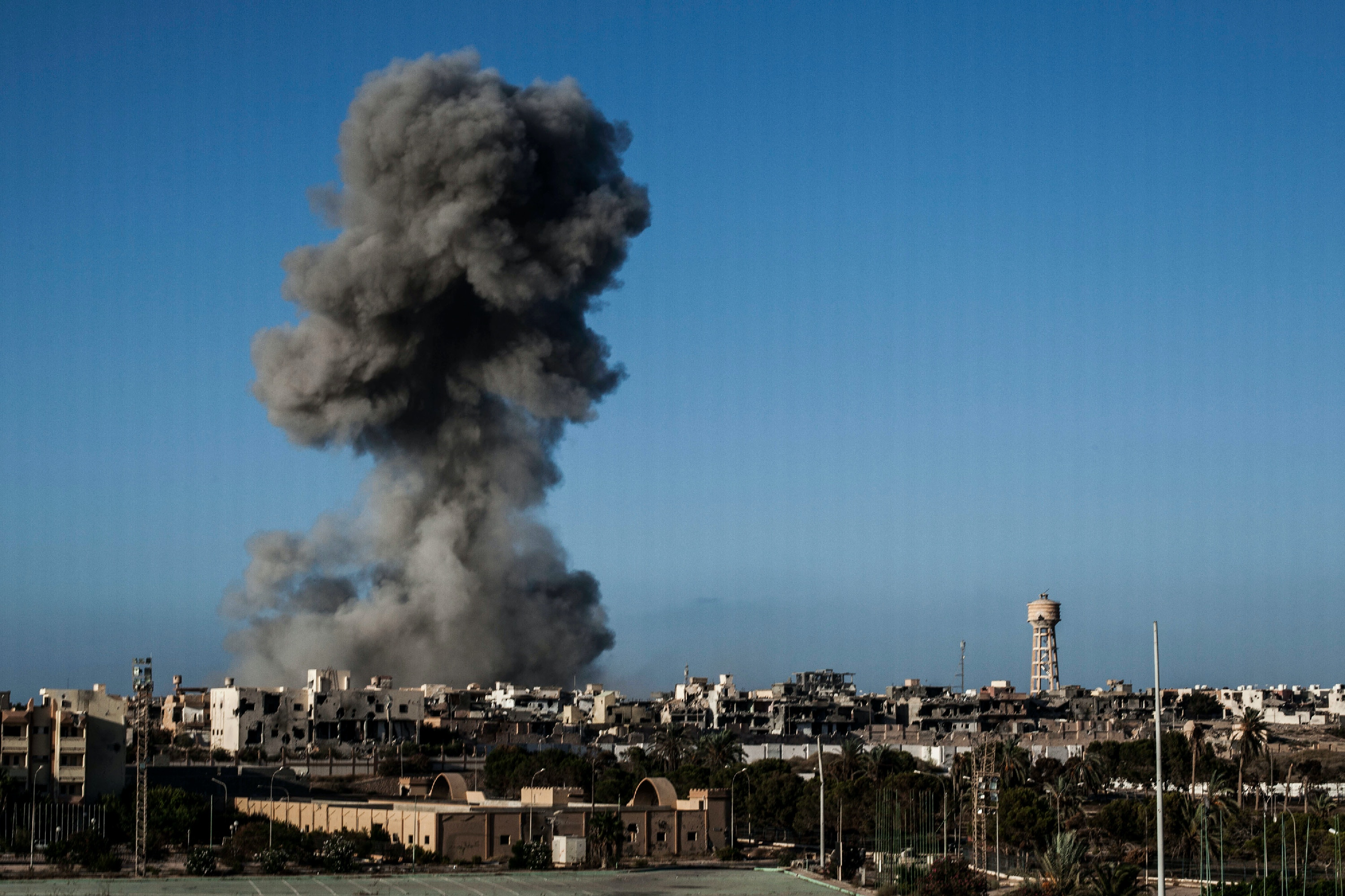 Smokes rises after an airstrike on an Islamic State militants held area in Sirte, Libya, Wednesday, Sept. 28, 2016. (AP Photo/Manu Brabo)