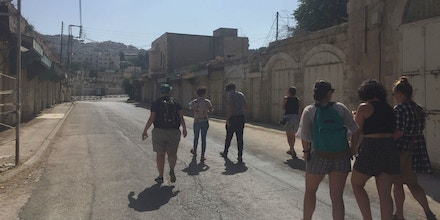 Five Birthright participants on Breaking the Silence tour of Hebron, in the occupied West Bank, after the walkout of their Birthright trip.