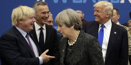 (L-R) British Secretary for Foreign Affairs Boris Johnson, NATO Secretary General Jens Stoltenberg, Britain's Prime Minister Theresa May, and US President Donald Trump arrive for a working dinner meeting at the NATO (North Atlantic Treaty Organization) summit at the NATO headquarters, in Brussels, on May 25, 2017.  / AFP PHOTO / POOL / Matt Dunham        (Photo credit should read MATT DUNHAM/AFP/Getty Images)