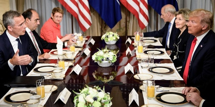 NATO Secretary General Jens Stoltenberg (L), US President Donald Trump (R), NATO Assistant Secretary General for Political Affairs and Security Policy Alejandro Alvargonzalez (2L), NATO Spokesperson Oana Lungescu (3L) and White House Chief of Staff John Kelly (3R) and US Ambassador to NATO Kay Bailey Hutchison (2R) speak at a breakfast meeting at the US chief of mission's residence in Brussels on July 11, 2018, ahead of a NATO (North Atlantic Treaty Organization) summit. (Photo by Brendan Smialowski / AFP)        (Photo credit should read BRENDAN SMIALOWSKI/AFP/Getty Images)