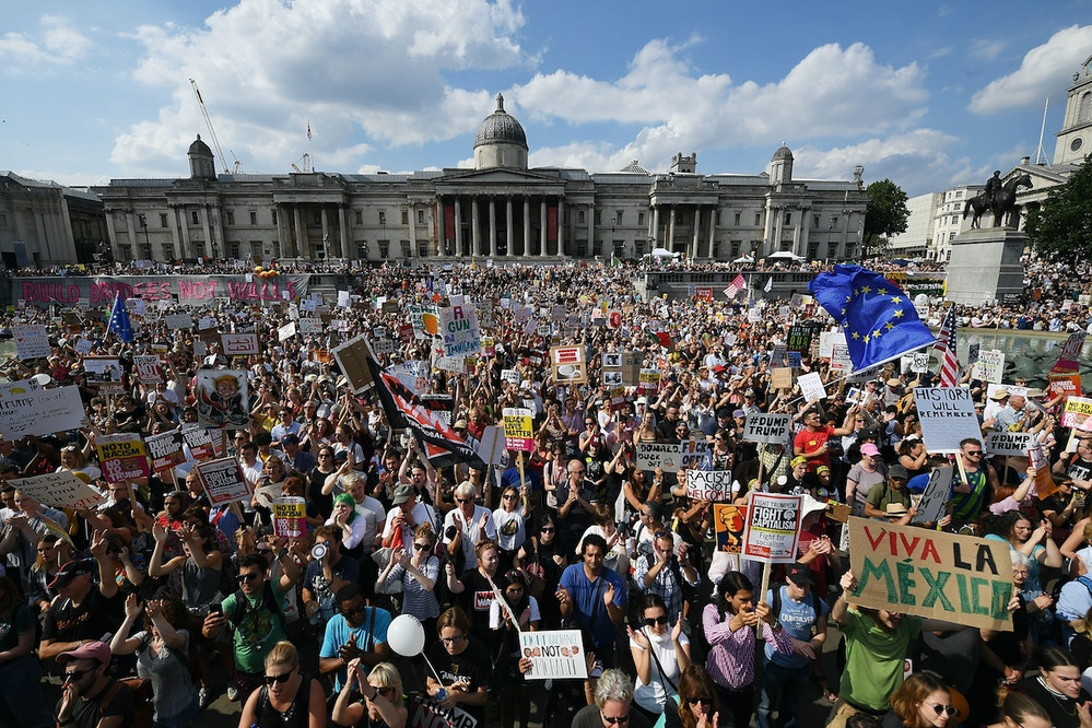 LONDON, ENGLAND - JULY 13:  Protesters take part in a demonstration against President Trump's visit to the UK in Trafalgar Square on July 13, 2018 in London, England. Tens of Thousands Of Anti-Trump protesters are expected to demonstrate in London and across the country against the UK visit by the President of the United States. Many people disagree with his policies that include migrant family separation, discrimination of transgender military personnel and changes to laws protecting women's sexual health.  (Photo by Chris J Ratcliffe/Getty Images)