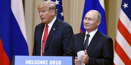 U.S. President Donald Trump and Russian President Vladimir Putin arrive during a join press conference at the Presidential Palace in Helsinki, Finland, Monday, July 16, 2018. (Jussi Nukari/Lehtikuva via AP)