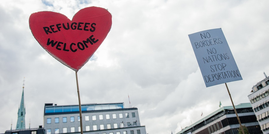 A sign reading 'refugees welcome' is pictured during a demonstration in solidarity with migrants seeking asylum in Europe after fleeing their home countries in Stockholm on September 12, 2015. AFP PHOTO/JONATHAN NACKSTRAND        (Photo credit should read JONATHAN NACKSTRAND/AFP/Getty Images)