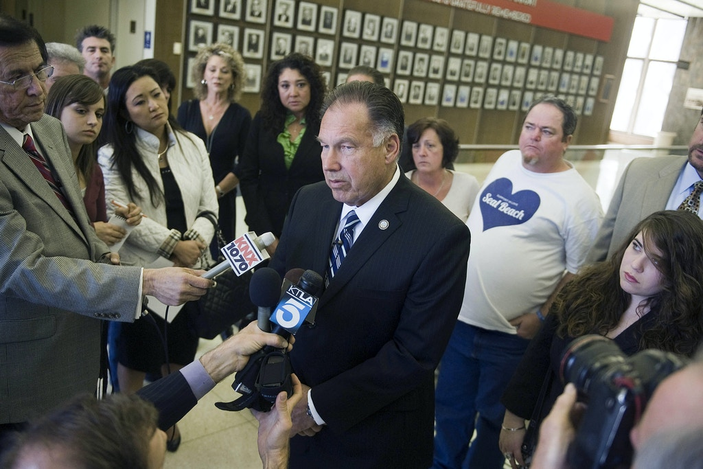 Surrounded by friends and family of Seal Beach shooting victims, Orange County District Attorney Tony Rackauckas talks to media after asking for the death penalty for Scott Evans Dekraai Wednesday, Jan. 18, 2012 in Santa Ana, Calif. Scott Evans Dekraai, accused of killing his ex-wife and seven other people at a Southern California salon last year has pleaded not guilty to a murder indictment that replaces charges originally filed by Orange County prosecutors. (AP Photo/Orange County Register, Jebb Harris)   MAGS OUT; LOS ANGELES TIMES OUT