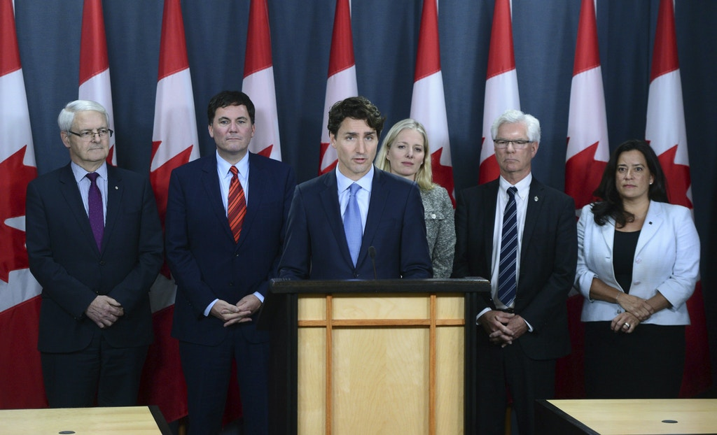 Canada's Prime Minister Justin Trudeau, center, holds a press conference at the National Press Theatre in Ottawa, Ontario, on Tuesday, Nov. 29, 2016. Trudeau has approved one controversial pipeline from the Alberta oil sands to the Pacific Coast, but rejected another. On Tuesday, he approved Kinder Morgan's Trans Mountain pipeline to Burnaby, British Columbia, but rejected Enbridge's Northern Gateway pipeline to Kitimat, B.C.  (Sean Kilpatrick/The Canadian Press via AP)