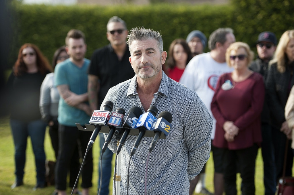 In this Saturday, Dec. 10, 2016, photo, Paul Wilson, whose wife Christy Lynn was one of eight people killed by Scott Dekraai five years earlier at a hair salon, speaks to the media during a news conference near the Salon Meritage memorial in Seal Beach, Calif. Families of some of the victims want prosecutors to accept a plea deal from the killer, while others want Dekraai to face the death penalty. (Kevin Sullivan/The Orange County Register via AP)