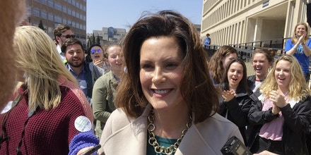 FILE - In this April 12, 2018, file photo, Michigan Democratic gubernatorial candidate Gretchen Whitmer speaks with reporters outside the state elections bureau in Lansing, Mich. Whitmer faces Shri Thanedar and Abdul El-Sayed in the Aug. 7, 2018 primary. (AP Photo/David Eggert, File)
