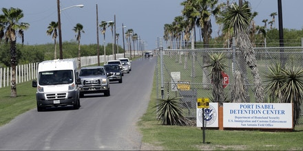 Vehicles leave the Port Isabel Detention Center, which holds detainees of the U.S. Immigration and Customs Enforcement, Tuesday, June 26, 2018, in Los Fresnos, Texas. (AP Photo/David J. Phillip)