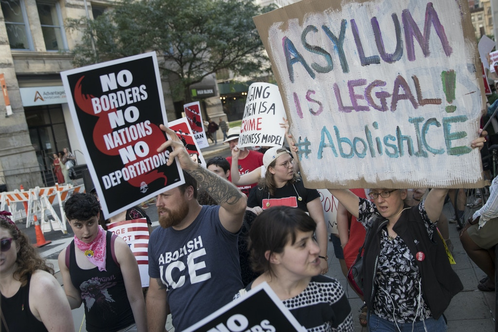 Protesters chant slogans outside a Federal court during a demonstration calling for the abolishment of Immigration and Customs Enforcement, or ICE, and demand changes in U.S. immigration policies, Friday, June 29, 2018, in New York. (AP Photo/Mary Altaffer)