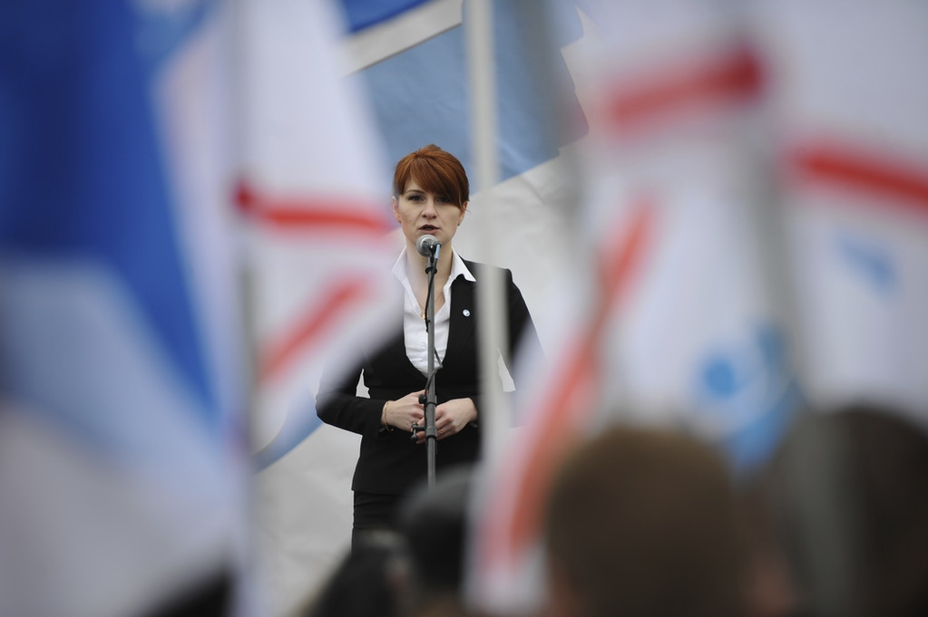 In this photo taken on Sunday, April 21, 2013, Maria Butina, leader of a pro-gun organization in Russia, speaks to a crowd during a rally in support of legalising the possession of handguns in Moscow, Russia . A 29-year-old gun-rights activist served as a covert Russian agent while living in Washington, gathering intelligence on American officials and political organizations and working to establish back-channel lines of communications for the Kremlin, federal prosecutors charged Monday. (AP Photo)