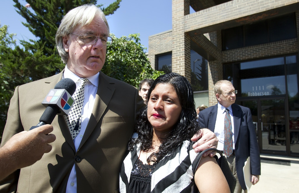 Attorney Curtis Woods, left, clutches his client, Encarnacion Bail Romero, minutes after a Greene County judge in Springfield, Mo., terminated her parental rights to the son she last held five years ago when he was seven months old. Romero, an illegal immigrant from Guatemala, was separated from her son when she was arrested in an immigration raid in southwest Missouri in May 2007. (AP Photo/The Kansas City Star, Tammy Ljungblad) ALL KANSAS CITY TELEVISION OUT, ONLINE OUT