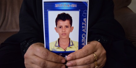 Maleka Alafif holds a photo of her 13-year-old son, Daoud, inside her family's apartment in Djibouti on July 3, 2018. Daoud received a visa to join his U.S.-citizen father in December; Maleka and her three older sons' applications were denied under the travel ban in March.