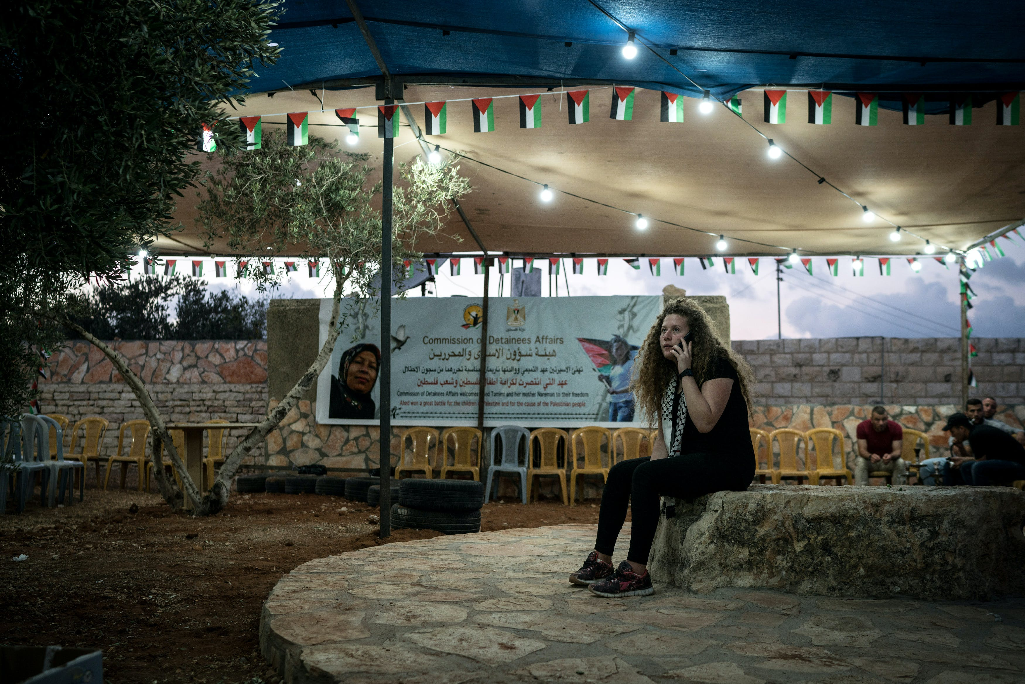 Ahed Tamimi speaks over the phone after journalsist and relatives left her house in Nabi Saleh on July 29, 2018 following the release of the Tamimi women.