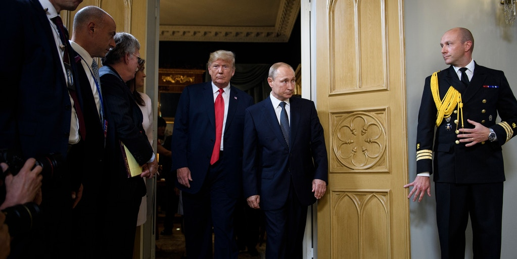 US President Donald Trump (Center L) and Russia's President Vladimir Putin (Center R) arrive for a meeting at Finland's Presidential Palace on July 16, 2018 in Helsinki, Finland. (Photo by Brendan Smialowski / AFP)        (Photo credit should read BRENDAN SMIALOWSKI/AFP/Getty Images)