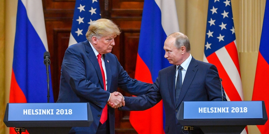 US President Donald Trump (L) and Russia's President Vladimir Putin shake hands before attending a joint press conference after a meeting at the Presidential Palace in Helsinki, on July 16, 2018. - The US and Russian leaders opened an historic summit in Helsinki, with Donald Trump promising an