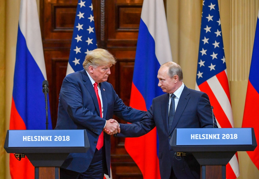 "US President Donald Trump (L) and Russia's President Vladimir Putin shake hands before attending a joint press conference after a meeting at the Presidential Palace in Helsinki, on July 16, 2018. - The US and Russian leaders opened an historic summit in Helsinki, with Donald Trump promising an ""extraordinary relationship"" and Vladimir Putin saying it was high time to thrash out disputes around the world. (Photo by Yuri KADOBNOV / AFP)        (Photo credit should read YURI KADOBNOV/AFP/Getty Images)"