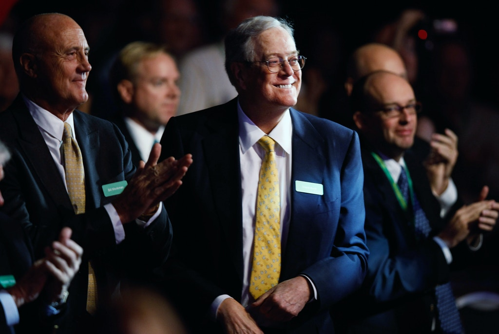 WASHINGTON, DC - NOVEMBER 04:  Americans for Prosperity Foundation chairman and  Koch Industries Executive Vice President David H. Koch (C) listens to speakers during the Defending the American Dream Summit at the Washington Convention Center November 4, 2011 in Washington, DC. The conservative political summit is organized by Americans for Prosperity, which was founded with the support of Koch and his brother David H. Koch.  (Photo by Chip Somodevilla/Getty Images)