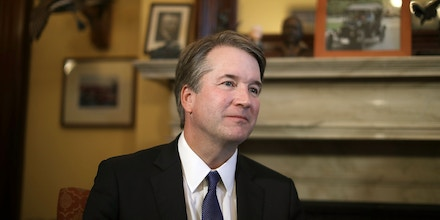 WASHINGTON, DC - JULY 11:  Judge Brett Kavanaugh listens to Sen. Rob Portman (R-OH) talk about Kavanaugh's qualifications before a meeting in the Russell Senate Office Building on Capitol Hill July 11, 2018 in Washington, DC. Kavanaugh is meeting with members of the Senate after U.S. President Donald Trump nominated him to succeed retiring Supreme Court Associate Justice Anthony Kennedy.  (Photo by Chip Somodevilla/Getty Images)