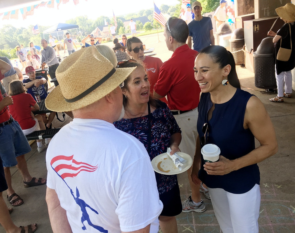 Sharice Davids, a Democrat running for Congress in Kansas, talks to supporters at a July 4 event in Prairie Village. (Photo by David Weigel/The Washington Post via Getty Images)
