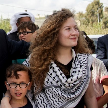 Basem (C), Ahed (R) and Nariman Tamimi arive in Nabi Saleh following the women's release on July 29, 2018.