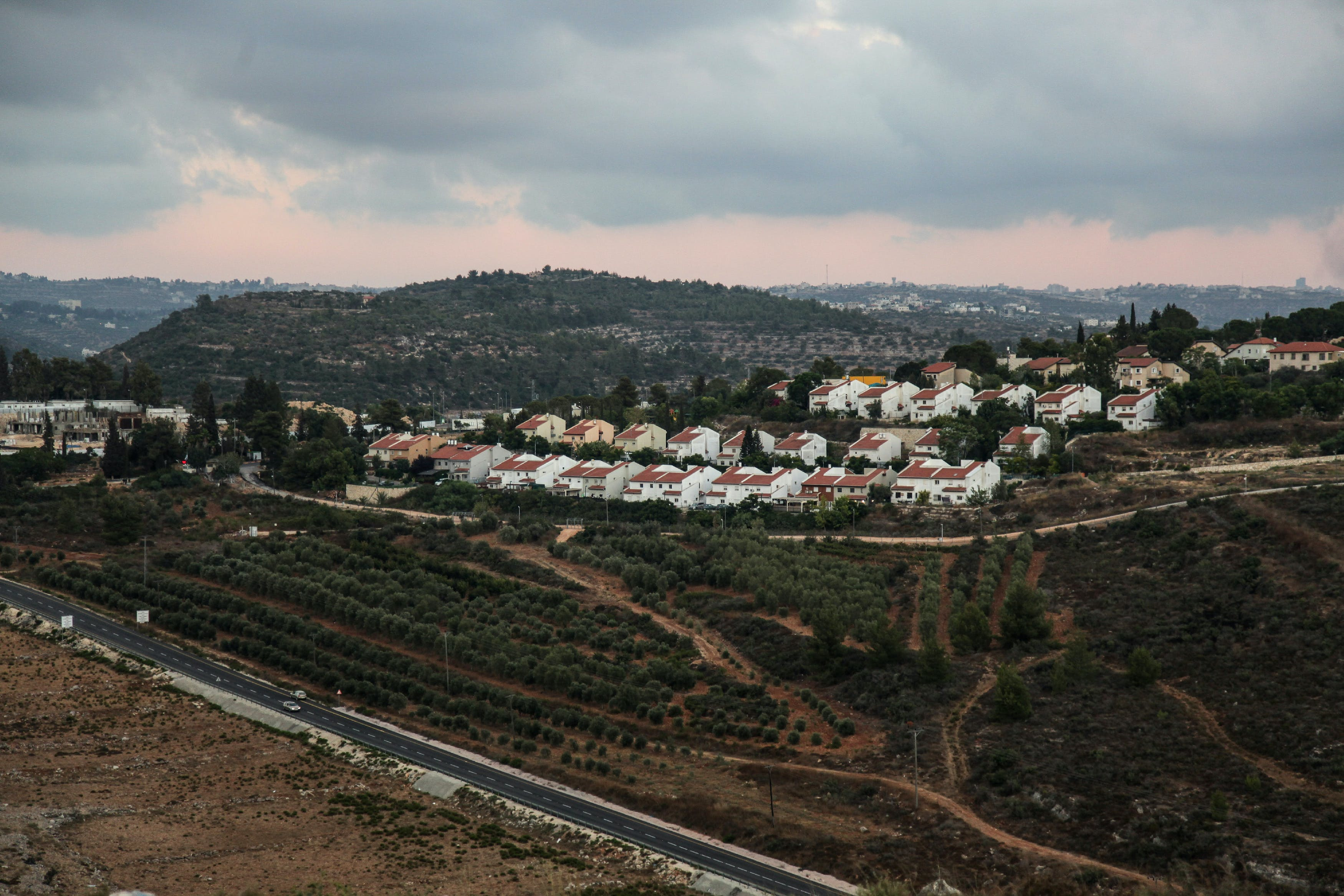 A general view taken from Nabi Saleh on July 29, 2018 shows the Israeli settlement of Halamish (C).