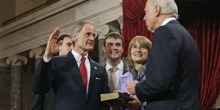 WASHINGTON, DC - JANUARY 03:  U.S. Sen. Tom Carper (D-DE) participates in a reenacted swearing-in with his wife Martha Ann Stacy and U.S. Vice President Joe Biden in the Old Senate Chamber at the U.S. Capitol  January 3, 2013 in Washington, DC. Biden swore in the newly-elected and re-elected senators earlier in the day on the floor of the current Senate chamber.  (Photo by Chip Somodevilla/Getty Images)