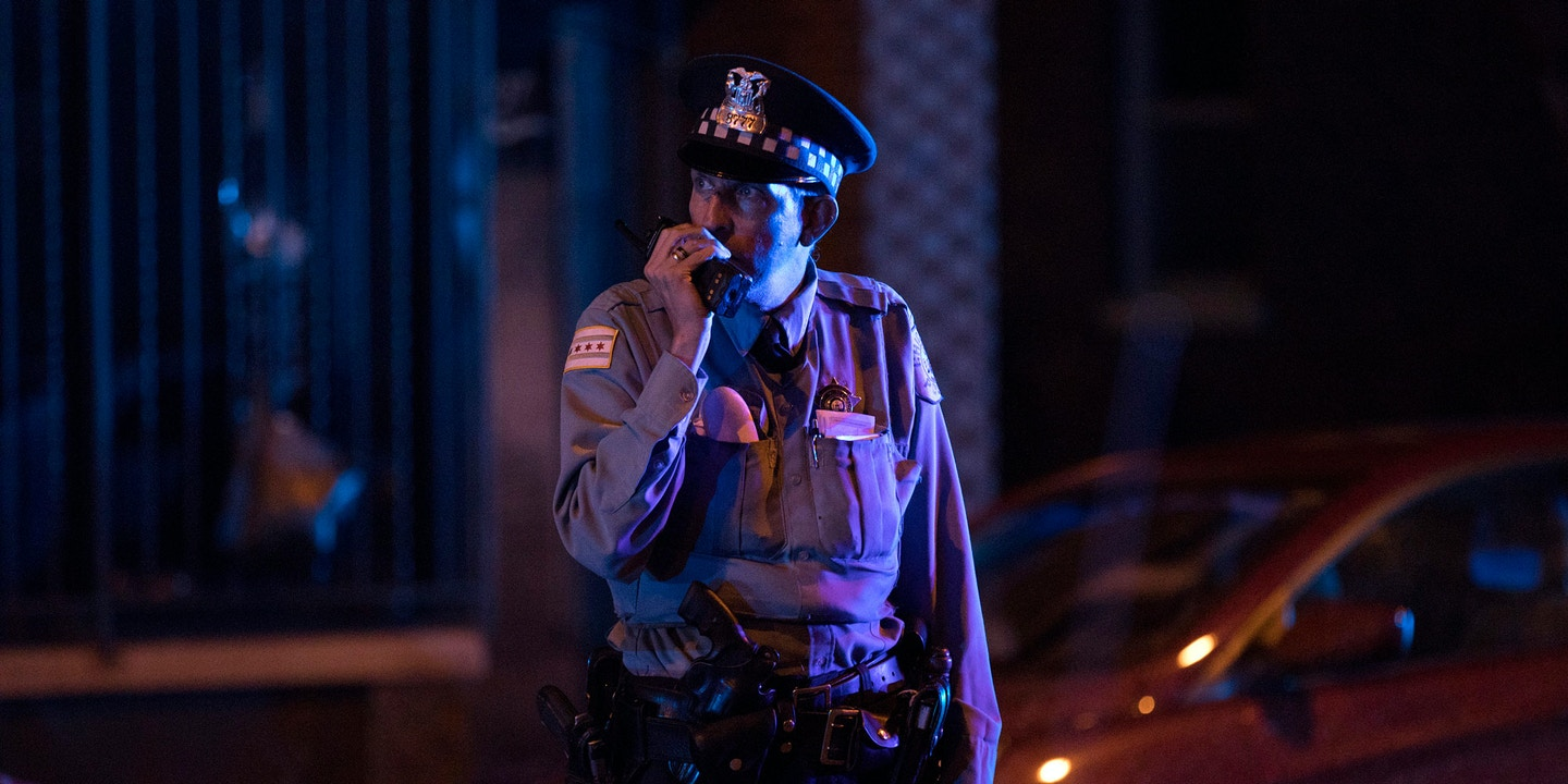 A Chicago police officer speaks on his radio at the scene where three people were shot, one fatally, in the 2500 block of West Lithuanian Plaza Court on Friday, July 28, 2017, in the Marquette Park neighborhood of Chicago, Ill. An 18-year-old man was shot in the head and pronounced dead at Advocate Christ Medical Center. A 34-year-old man and a 33-year-old woman were wounded. (Erin Hooley/Chicago Tribune/TNS via Getty Images)
