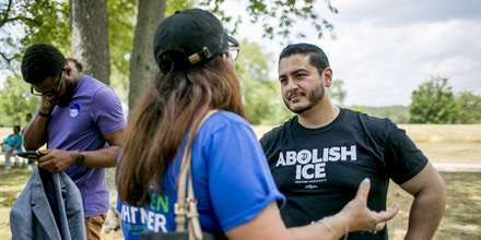 Abdul El-Sayed, a liberal candidate for governor of Michigan, works the crowd at a barbecue in Milford, Mich., July 15, 2018. El-Sayed, an advocate of single-payer health care running an uphill race to become the country's first Muslim governor, is part of a wave of young politicians redefining the left in the Democratic Party. (Anthony Lanzilote/The New York Times)