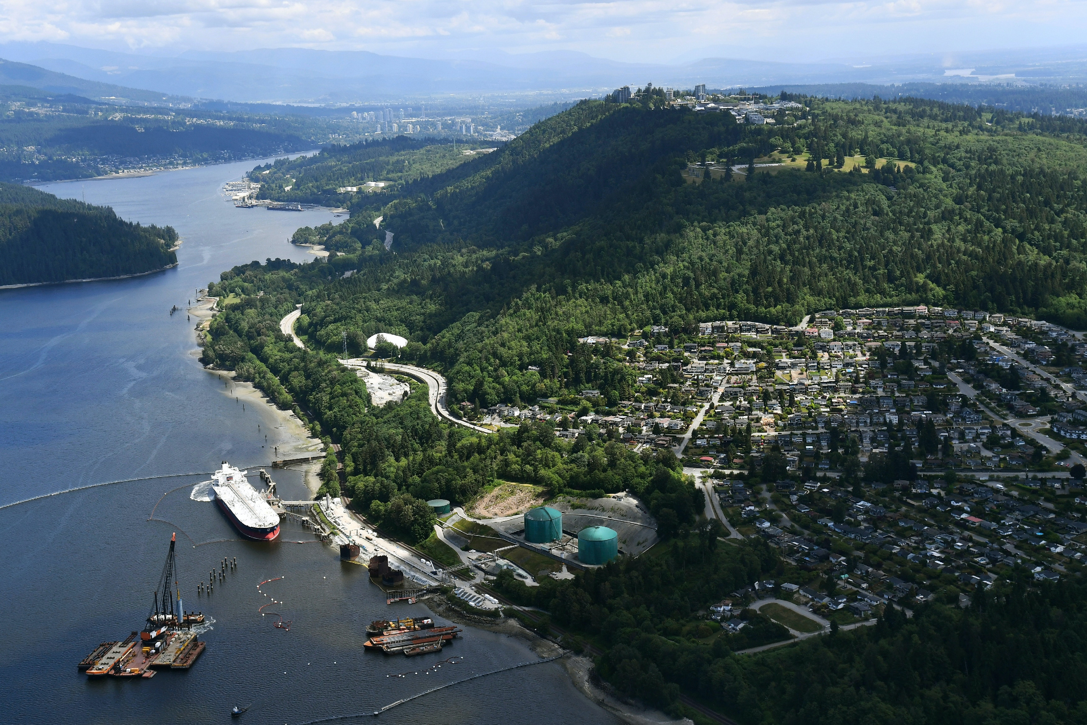 A aerial view of Kinder Morgan's Trans Mountain marine terminal, in Burnaby, British Columbia, is shown on Tuesday, May 29, 2018. The federal Liberal government is spending $4.5 billion to buy Trans Mountain and all of Kinder Morgan Canada's core assets, Finance Minister Bill Morneau said Tuesday as he unveiled the government's long-awaited, big-budget strategy to save the plan to expand the oil pipeline. (Jonathan Hayward/The Canadian Press via AP)