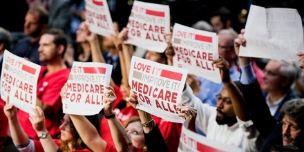 UNITED STATES - SEPTEMBER 13: The audience waves signs as Sen. Bernie Sanders, I-Vt., speaks during his event to introduce the Medicare for All Act of 2017 on Wednesday, Sept. 13, 2017. (Photo By Bill Clark/CQ Roll Call) (CQ Roll Call via AP Images)